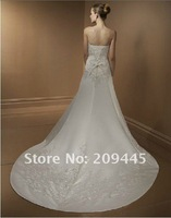 Long trailing court style of wedding dress tailored wedding