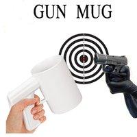 Free shipping 2 pcs/lot  hot sell novelty pistol cup/ white and black two colors ceramic gun mug