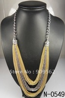 Plus three long white gold necklace