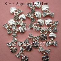 Free shipping 50pcs/bag Silver Bow Crystal Rhinestone Metal Nail Decoration Lovely Outlooking Nail Art Decorations
