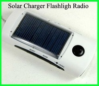 Wholesale!100pcs/lot Solar Mobile phone Charger With FM Radio&Solar Charger&LED light  flashlight / torch DHL Free Shipping