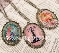 Free shipping/ Lace more stones cut flowers grows necklace Eiffel Tower peacock sweater chain