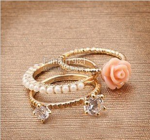 Min. Order is 15 USD( Mix order)!  Rose Floral/Flower/Pearl/Crystal Finger Rings. A set has three pcs . RG097001