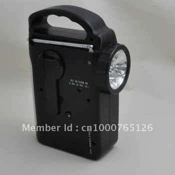 Multi-function solar LED hand crank dynamo flashlight with radio