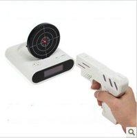 Hot sale New novelty digital Creative alarm clock,gun shooting target Clocks,fashion wake up clocks toys,Free shipping