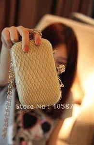 Free Shipping 2012 Korean version snake pattern Skull clutch evening bag Chain-type Leisure bags