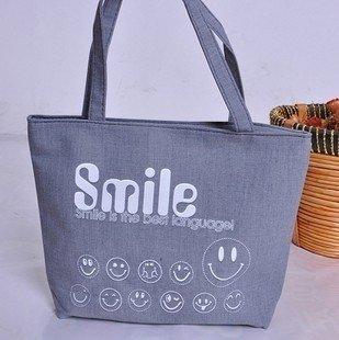 Free shipping,Smile cloth handbag+ fashionable canvas handbags wholesale and retail(China (Mainland))
