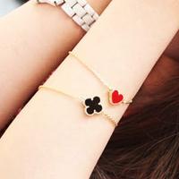 E5041 fashion accessories vintage peach heart love clover bracelet (KE)