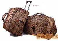 Free shipping unisex cartoon trolley travel bag with rolling wheels huge volume women & men jacquard luggage bags