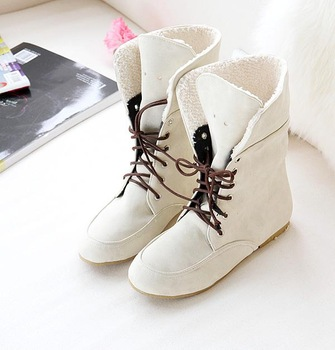 New Arrival Free Shipping 2012 new arrival sweet perforated lacing round toe flat heel boots martin boots plus size shoes