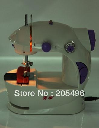 Free Shipping Electric sewing machine with led light min portable cloth fabric stitching machine household multifunctional(China (Mainland))