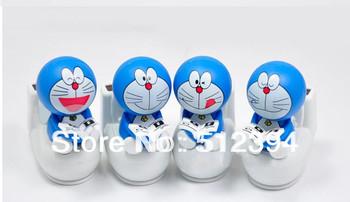 Free Shipping mini Doraemon machine cat sit on closestool solar power toy Doraemon reading doll home car decoration children toy