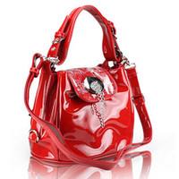The new female sweet candy bag patent leather handbag Korean Shoulder Messenger bucket packet