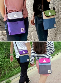 Free shipping 3 pcs New Arrial Multifunctional iPad case/computer bag/Mini shoulder bag/travel storage bag/Three colors