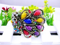 MIN.ORDER $15, fashion bronze hollowed bangle with big stones inset on colorful peacock
