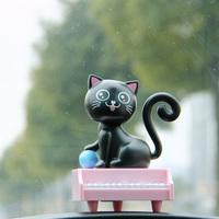 Solar doll baby swing car decoration piano cat