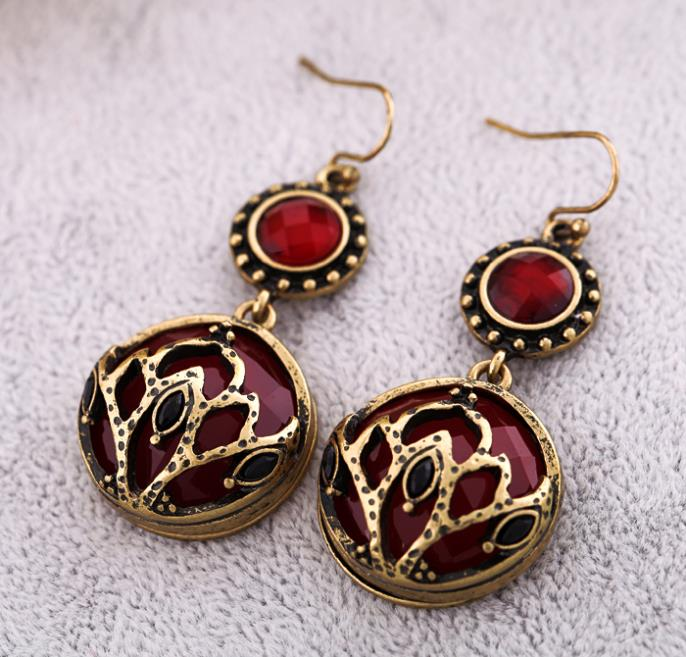 Free shipping 2013 charm tops fashion jewelry vintage luxury graceful the red simulated diamond crown women's earrings hot sales(China (Mainland))