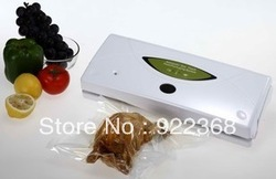 Free shipping by DHL/FEDEX,fruit vacuum packaging,household vacuum machine.chicken packer(China (Mainland))