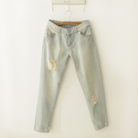 Self-restraint water wash wearing white retro finishing hole light color jeans