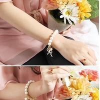 E2026 women's jewelry pearl elegant bow elastic bracelet 29g