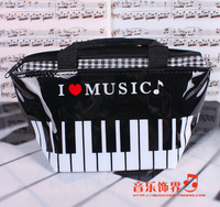 Music bag multifunctional patent leather cosmetic bag Women notes piano bags handbag
