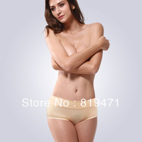 Women's solid color panties seamless mid waist abdomen drawing lycra cotton panties