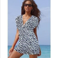 Free Shipping European version of the Beach ice silk dress deep V collar bikini dress was thin sexy 4-color