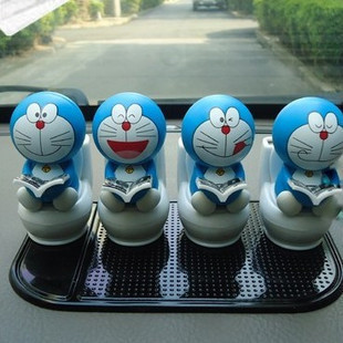 Car accessories ornaments car accessories Solar shook his head doll shaking his head doll mini sitting toilet reading