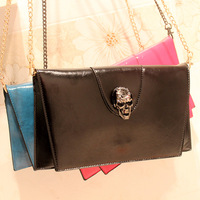 Free shipping 2013 skull day clutch black oil skin glossy envelope bag brief chain small bags women's handbag