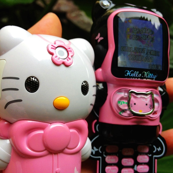 Lovely Hello Kitty Pink color HK520 Children Lady Mini Mobile Phone Dual Sim Card Russian Polish Menu Slider C168(China (Mainland))