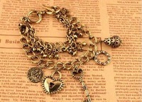 Min. Order is $10 ( Can Mix order ) ! Vintage accessories gold heart key multi-element bracelet sl050