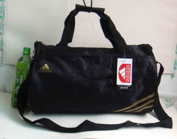 2010 sports gym bucket cylinder handbag messenger black gold(China (Mainland))