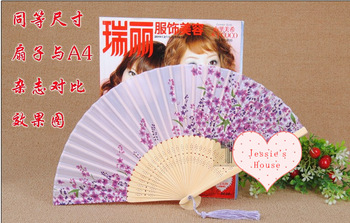 chinese or Japanese style beautiful silk and bamboo fan by hand, folding, present, crafts