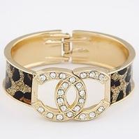 free shipping hotsale in 2013 gold bangle bracelet for women size 63*58*28mm