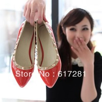 Free shipping,casual women flat shoes pointed,high-grade patent leather flat with non-slip metal rivets single shoes Liu spikes