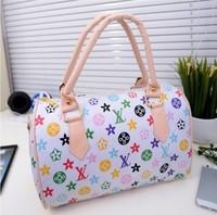 Spring hot sell The new fashion Leather handbag Portable fashion leisure one shoulder bag Locomotive bucket bag