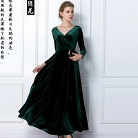 The new , high- quality, thin gold velvet long-sleeved , long big swing dress temperament ,