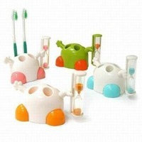 children and adult  tooth brush stand with sand clock