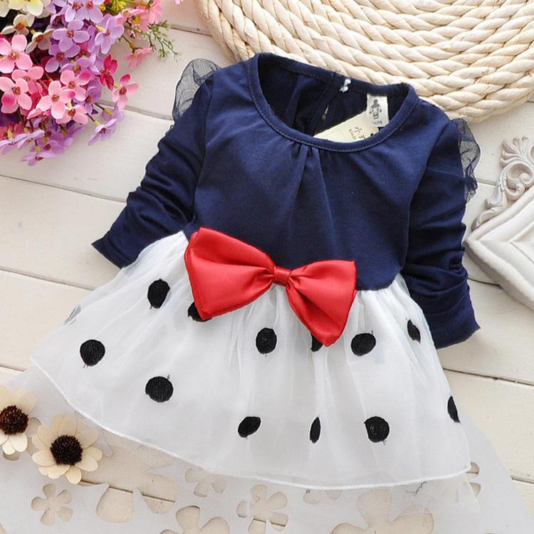 2014 Autumn new baby girls dress Korean boats dot bow Puff Sleeve bow Kids children's clothes Long sleeve navy blue veil pink(China (Mainland))
