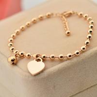 Hot new female hearts hanging bells love beads bracelet 14k rose gold bracelet