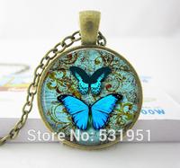 Wholesale Blue Butterfly Necklace. Vintage Globe Pendant. Charms. Butterfly Jewelry glass photo pendant necklace