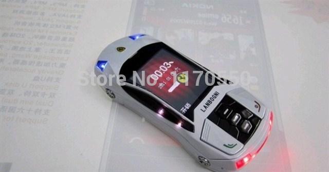 2014 Hot F8 car cell phone Dual SIM slider Camera Bluetooth FM Radio car key phone mini size colorful neon light mobile phone(China (Mainland))