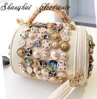 2014 new Korean retro fashion wave pattern personalized buttons fringed bag hand shoulder bag diagonal package cylinder