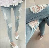 Korea purchasing new Korean version of Women 2014 Summer Slim was thin hole jeans pants feet pants