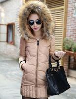 2014  New winter coat women thicken warm Large luxurious fur collars medium-long women's down jacket  parka