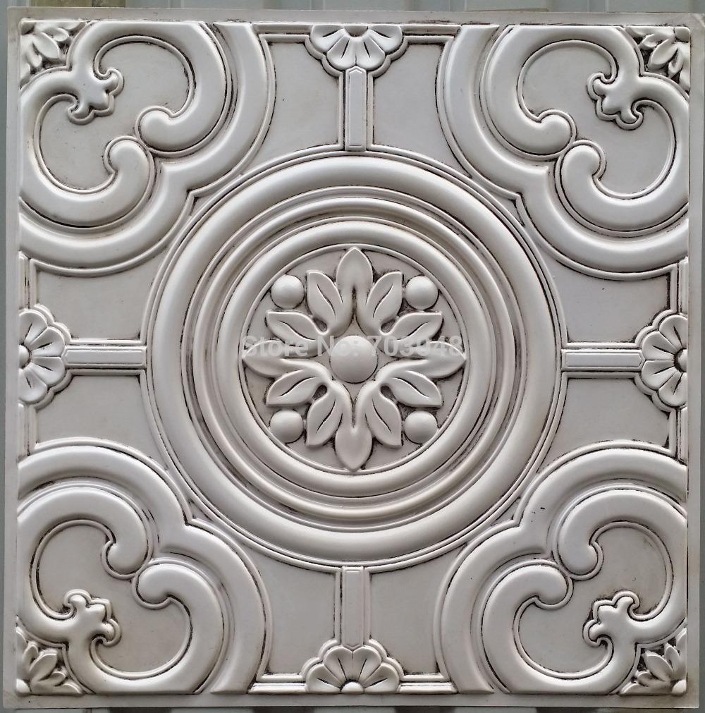 Embossed metal ceiling tiles