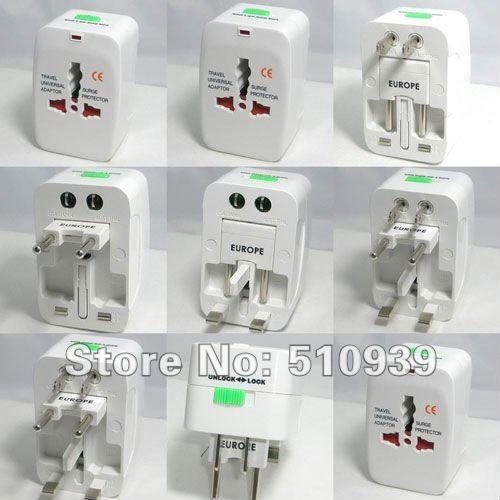 Brand New Surge Protector Universal International Travel Power Adapter Plug (US/UK/EU/AU AC Plug) Guaranteed 100% free shipping(China (Mainland))