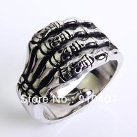 Tidal current punk male men's Men boys stainless steel skull hand ring Skeletal hand ring