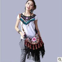 The original folk style embroidered bag tassel hanging ear shoulder obliquely across the canvas bag