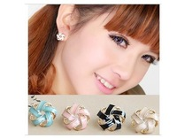 Fashion elegant rotation pattern stud earrings  free shipping